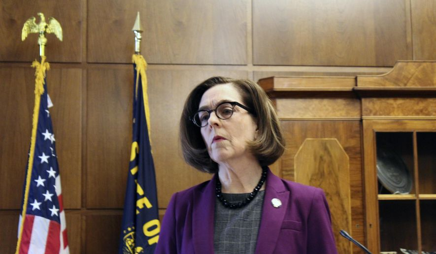 FILE - In this Feb. 24, 2020, file photo, Oregon Gov. Kate Brown speaks in Salem, Ore. Gov. Brown on Wednesday, June 3, 2020, discussed the state's phase 2 coronavirus reopening plan, which includes loosening current restaurant restrictions, opening pools and expanding outdoor gatherings to 100 people. (AP Photo/Andrew Selsky, File)