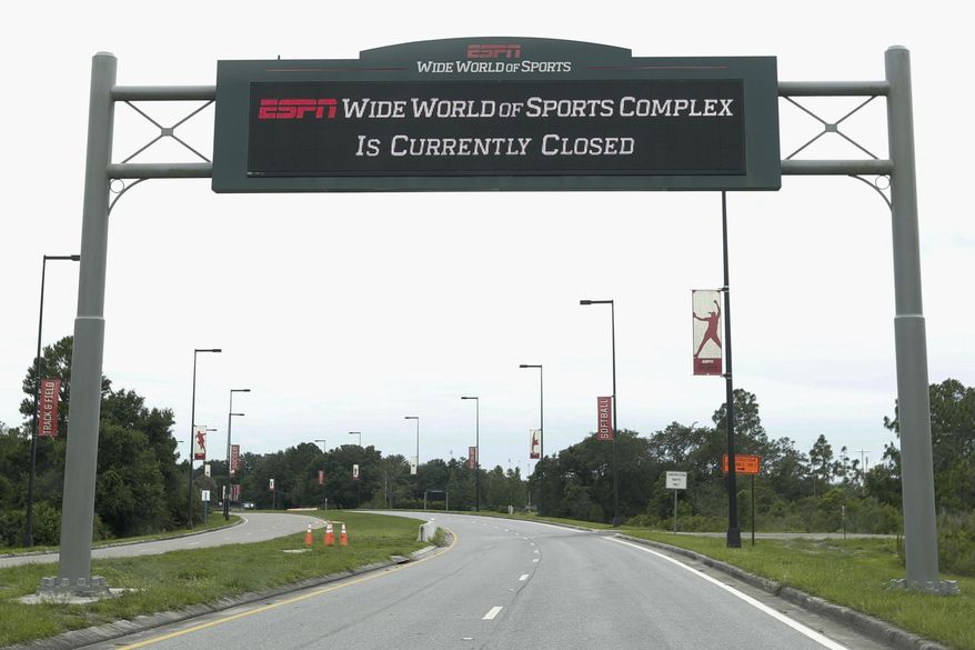 A sign at the entrance to ESPN's Wide World of Sports at Walt Disney World is seen Wednesday, June 3, 2020, in Kissimmee, Fla. The NBA has told the National Basketball Players Association that it will present a 22-team plan for restarting the season at Disney. (AP Photo/John Raoux)  **FILE**