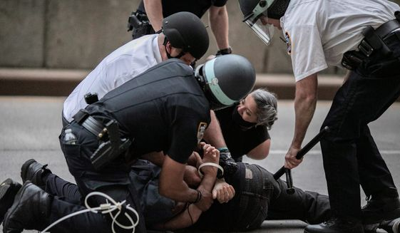New York City is one of four cities where serious charges against hundreds of protesters arrested for rioting and looting have been dismissed. (Associated Press)
