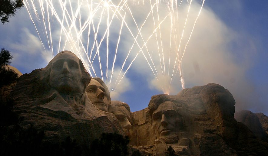 Fireworks light up the night sky over Mt. Rushmore National Memorial, S.D., Tuesday night, July 3, 2007, during the 10th annual Heartland of America Independence Day Celebration at the Shrine of Democracy. (AP Photo/Rapid City Journal, Seth A. McConnell) ** MANDATORY CREDIT **