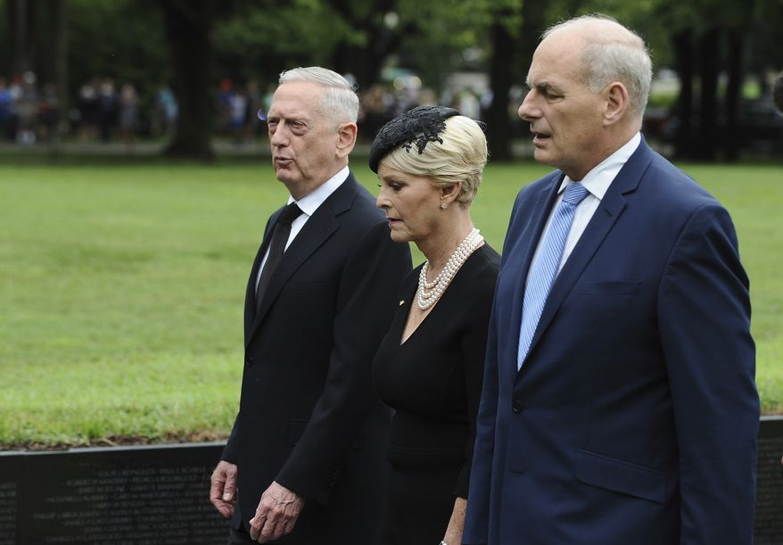 Cindy McCain, wife of late Sen. John McCain, R-Ariz., with Secretary of Defense James Mattis, left, and White House Chief of Staff John Kelly, depart after laying a ceremonial wreath honoring all whose lives were lost during the Vietnam War at at the Vietnam Veterans Memorial in Washington, Saturday, Sept. 1, 2018. (Mary F. Calvert/Pool photo via AP)