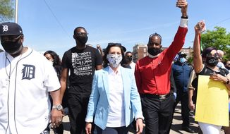 Michigan Gov. Gretchen Whitmer, center, marches with others, on Woodward during a rally in Highland Park, Thursday, June 4, 2020, in honor of George Floyd, a man who died last week while being arrested by Minneapolis police. (Clarence Tabb, Jr./Detroit News via AP)