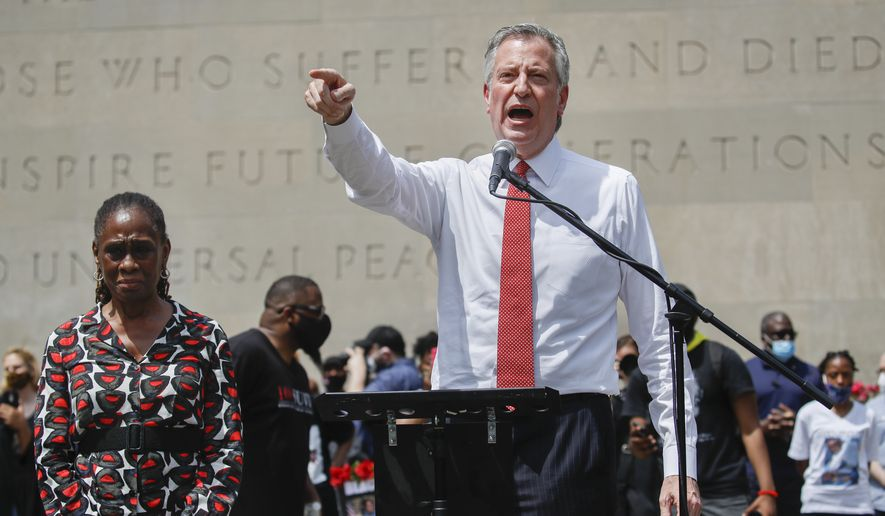 New York City Mayor Bill de Blasio speaks alongside his wife Chirlane McCray in the Brooklyn borough of New York. (AP File Photo/John Minchillo)