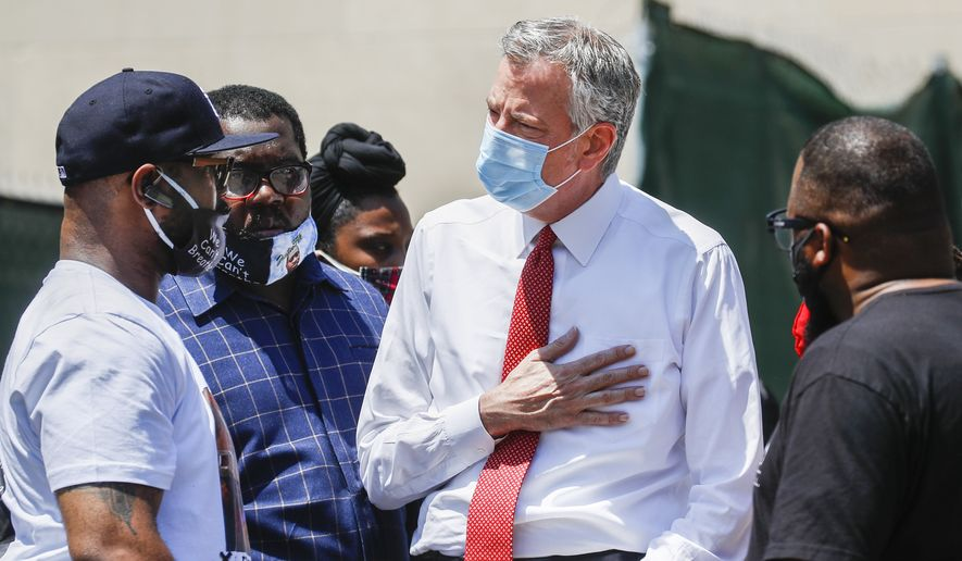 Terrence Floyd, brother of the deceased George Floyd, speaks with New York City Mayor Bill de Blasio, right, during a rally at Cadman Plaza Park, Thursday, June 4, 2020, in the Brooklyn borough of New York. Protests continued following the death of George Floyd, who died after being restrained by Minneapolis police officers on May 25. (AP Photo/John Minchillo)