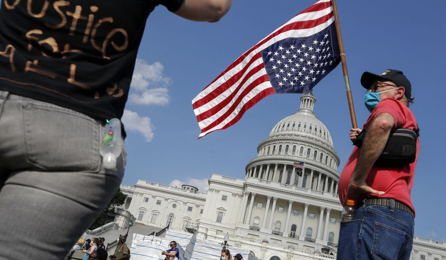 Demonstrators protest Thursday, June 4, 2020, on the West Front of the U.S. Capitol in Washington, over the death of George Floyd, a black man who was in police custody in Minneapolis. Floyd died after being restrained by Minneapolis police officers. (AP Photo/Alex Brandon)