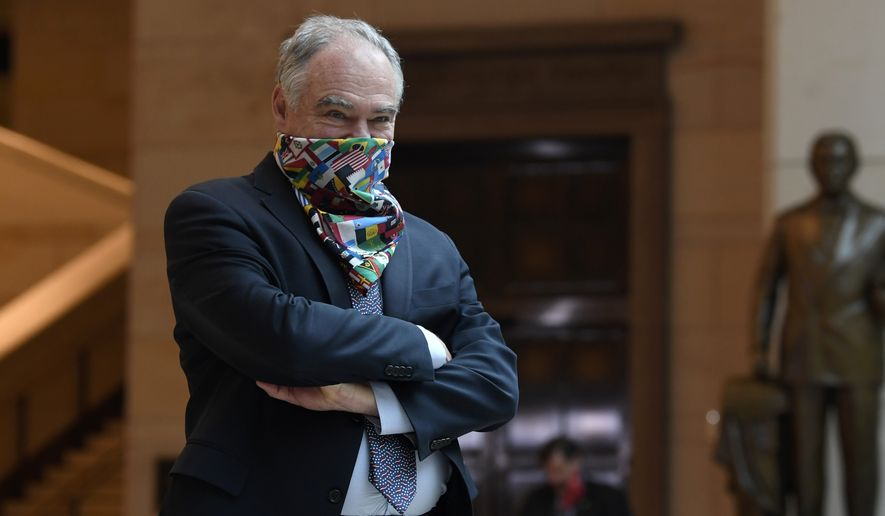 Sen. Tim Kaine, D-Va., waits to joins other Democratic Senators for an 8 minutes and 46 second pause on Capitol Hill in Washington, Thursday, June 4, 2020, to commemorate the life of George Floyd, who died after being restrained by Minneapolis police officers. (AP Photo/Susan Walsh)