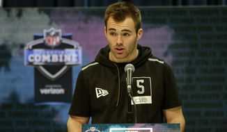 """In this Feb. 25, 2020, file photo, Georgia quarterback Jake Fromm speaks during a press conference at the NFL football scouting combine in Indianapolis. Buffalo Bills rookie quarterback Jake Fromm apologized for using the phrase """"elite white people"""" in a text conversation from more than a year ago, and posted on social media early Thursday morning, June 4, 2020. The former Georgia starter posted his apology on his Twitter account, in which he wrote: """"I'm truly sorry for my words and actions and humbly ask for forgiveness."""" (AP Photo/Michael Conroy, File)"""