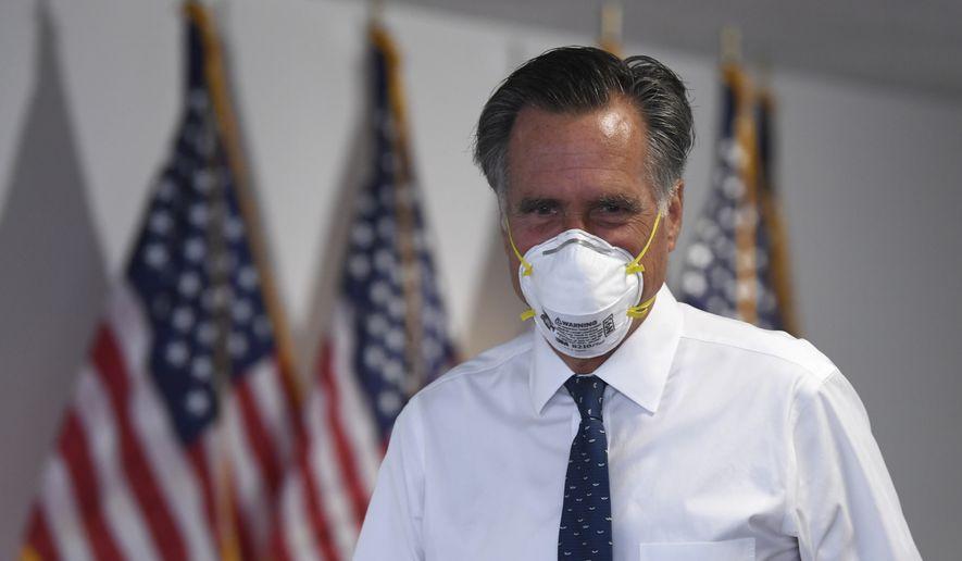 Sen. Mitt Romney, R-Utah, leaves a Republican luncheon on Capitol Hill in Washington, Thursday, June 4, 2020. (AP Photo/Susan Walsh) ** FILE **
