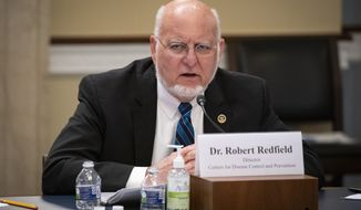 Dr. Robert Redfield, director of the Centers for Disease Control and Prevention, testifies at a Labor, Health and Human Services, Education, and Related Agencies Appropriations Subcommittee hearing about the COVID-19 response on Capitol Hill in Washington, Thursday, June 4, 2020. (Al Drago/Pool via AP)