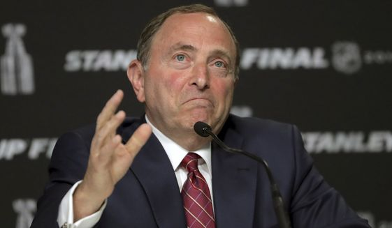 In this May 27, 2019, file photo, NHL Commissioner Gary Bettman speaks to the media before Game 1 of the NHL hockey Stanley Cup Final between the St. Louis Blues and the Boston Bruins, in Boston. The NHL nailed down the final details of a playoff format if the season can resume on the same day word came out that another player has tested positive for the coronavirus. (AP Photo/Charles Krupa) ** FILE **