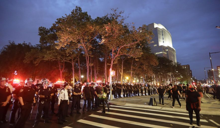 New York Police Officers block Cadman Plaza West as protesters rally calling for justice over the death of George Floyd, Wednesday, June 3, 2020, in the Brooklyn borough of New York. Floyd died after being restrained by Minneapolis police officers on Memorial Day. (AP Photo/Frank Franklin II)