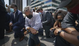 Philadelphia District Attorney Larry Krasner takes a knee in honor of the memory of George Floyd on Thursday, June 4, 2020, in Philadelphia. (Jessica Griffin/The Philadelphia Inquirer via AP) ** FILE **