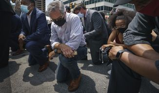 Philadelphia District Attorney Larry Krasner takes a knee in honor of the memory of George Floyd on Thursday, June 4, 2020, in Philadelphia. (Jessica Griffin/The Philadelphia Inquirer via AP)