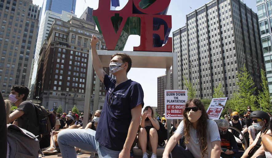 Protesters rally at LOVE Park on Thursday, June 4, 2020, in Philadelphia during a demonstration over the death of George Floyd, who died May 25 after being restrained by police in Minneapolis. (Charles Fox/The Philadelphia Inquirer via AP)