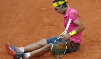 FILE - In this May 31, 2009, file photo, defending champion Rafael Nadal sits on the clay after falling during his fourth round match against Robin Soderling at the French Open tennis tournament in Paris. Soderling upset Nadal 6-2, 6-7, 6-4, 7-6, for Nadal's first French Open loss. (AP Photo/Christophe Ena, File)