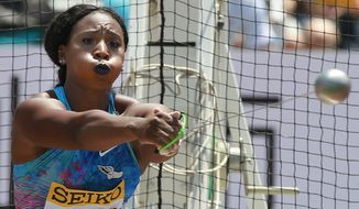 FILE - In this May 21, 2017, file photo, Gwen Berry, of the United States, competes in the women's hammer throw at the Golden Grand Prix athletics meet in Kawasaki, near Tokyo. Berry captured headlines last year when she used her turn on the gold-medal podium at the Pan-Am Games to raise her fist as a show of her frustration with America's treatment of blacks. Her gesture, to say nothing of the punishment that came afterward, are all being seen in a new light these days, in the wake of the killing of George Floyd. (AP Photo/Shizuo Kambayashi, File)