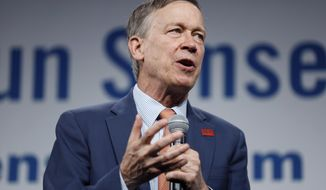 FILE - In this Aug. 10, 2019, file photo, Democratic presidential candidate former Colorado Gov. John Hickenlooper speaks in Des Moines, Iowa. Democratic U.S. Senate candidate John Hickenlooper didn't appear at a Colorado Independent Ethics Commission hearing Thursday, June 4, 2020, defying a commission subpoena and a court order that he participate as it considers a Republican complaint that trips he took on private planes while Colorado's governor violated the state's gift ban. (AP Photo/Charlie Neibergall, File)