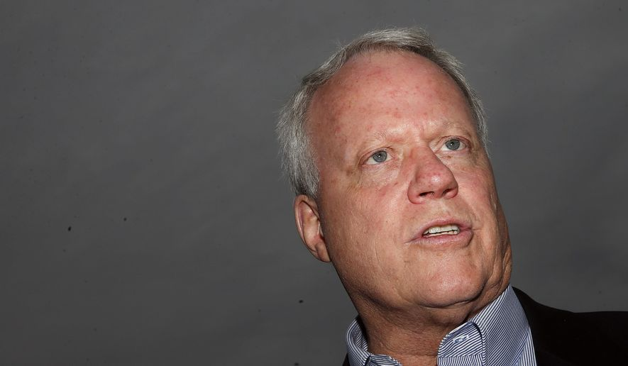 """FILE - In this May 17, 2014 file photo Rep. Paul Broun, R-Ga, and candidate for US Senate talks to voters during the """"Grillin with the Governor"""" campaign event in Buford, Ga. Broun is running in Georgia's 9th Congressional District. (AP Photo/John Bazemore, File)"""