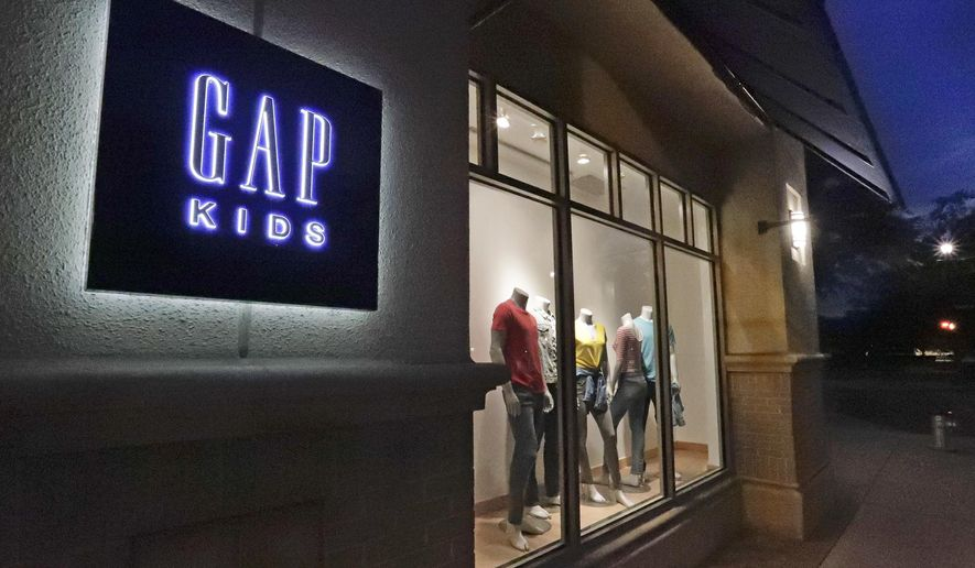 FILE - This Aug. 23, 2018, file photo shows a window display at a Gap Kids clothing store in Winter Park, Fla. Gap is being sued for refusing to pay rent for stores temporarily closed during the coronavirus pandemic. Mall owner Simon Property Group says in a lawsuit filed this week of June 4, 2020, that the clothing retailer owes three months of rent, totaling $65.9 million AP Photo/John Raoux, File)