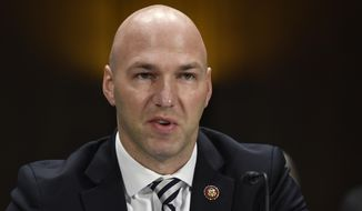 In this Tuesday, Feb. 11, 2020, photo, Rep. Anthony Gonzalez, R-Ohio, speaks during a Senate Commerce subcommittee hearing on Capitol Hill in Washington, on intercollegiate athlete compensation. (AP Photo/Susan Walsh) ** FILE **