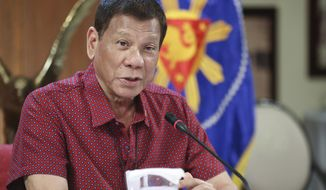 FILE - In this May 28, 2020, file photo provided by the Malacanang Presidential Photographers Division, Philippine President Rodrigo Duterte, talks during his speech at the Malacanang presidential palace in Manila, Philippines. The U.N. human rights office called on the Philippines government in a new report Thursday, June 4, to end all violence targeting suspected drug offenders and to disband private and state-backed paramilitary groups which have caused serious human rights violations in the country.(Ace Morandante/Malacanang Presidential Photographers Division via AP, File)