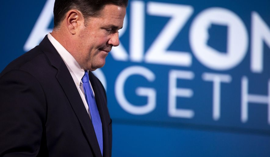Arizona Gov. Doug Ducey speaks at a press conference about protests and COVID-19 in Arizona Thursday, June 4, 2020, at the Arizona Commerce Authority Conference Center in Phoenix. (Sean Logan/The Arizona Republic via AP, Pool)