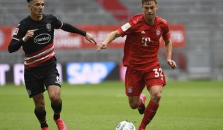 Duesseldorf's Alfredo Morales, left, and Bayern's Joshua Kimmich challenge for the ball during the German Bundesliga soccer match between FC Bayern Munich and Fortuna Duesseldorf in Munich, Germany, Saturday, May 30, 2020. Because of the coronavirus outbreak all soccer matches of the German Bundesliga take place without spectators. (Christof Stache/Pool via AP)