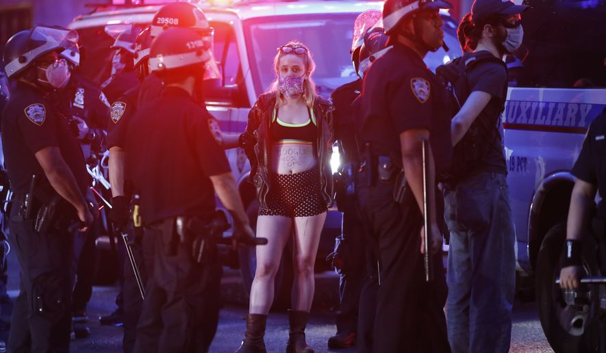Protesters are arrested by New York Police Department officers on Park Avenue after violating curfew, Friday, June 5, 2020, in New York. Protests continued following the death of George Floyd, who died after being restrained by Minneapolis police officers on May 25. (AP Photo/John Minchillo)