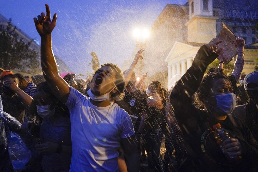 Demonstrators protest, Thursday, June 4, 2020, near the White House in Washington, over the death of George Floyd, a black man who was in police custody in Minneapolis. Floyd died after being restrained by Minneapolis police officers. (AP Photo/Evan Vucci)