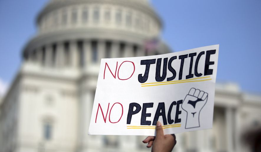 Demonstrator protest on Capitol Hill, Thursday, June 4, 2020, in Washington, during a protest over the death of George Floyd, an unarmed black man, who died after a police officer kneeled on his neck for several minutes. (AP Photo/Jose Luis Magana)