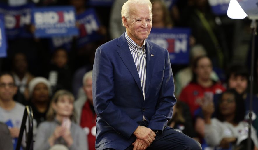 In this Feb. 29, 2020, file photo Democratic presidential candidate former Vice President Joe Biden smiles at supporters during a campaign event at Saint Augustine's University in Raleigh, N.C. Biden has won the last few delegates he needed to clinch the Democratic nomination for president. (AP Photo/Gerry Broome, File)