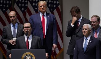 President Donald Trump listens as Treasury Secretary Steven Mnuchin speaks during a news conference in the Rose Garden of the White House, Friday, June 5, 2020, in Washington. (AP Photo/Evan Vucci)