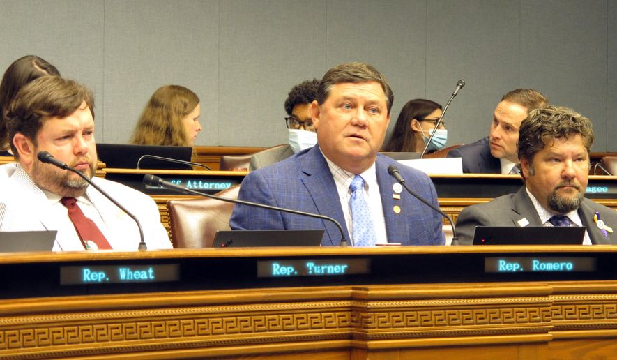 Rep. Troy Romero, R-Jennings, center, asks questions about next year's budget proposal as Reps. Chris Turner, R-Ruston, left, and Daryl Deshotel, R-Hessmer, right, listen during a meeting of the House Appropriations Committee on Friday, June 5, 2020, in Baton Rouge, La. (AP Photo/Melinda Deslatte)