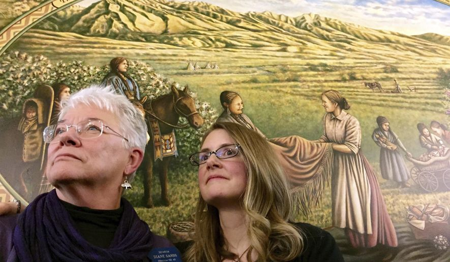 "FILE - In this Jan. 7, 2015, file photo, State Sen. Diane Sands, left, and artist Hadley Ferguson of Missoula stand in front of a mural honoring Montana women as community builders at its unveiling at the state Capitol in Helena, Mont. Members of the Montana Democratic Party met remotely on Friday, June 5, 2020, to vote on the party's platform, including the addition of a statement in reaction by the death of George Floyd opposing the use of force by law enforcement during arrests. Sen. Diane Sands, D-Missoula, who led a Zoom meeting on the party's crime and justice platform, voiced support for the amendment. ""I think it is important that we address the current national situation,"" Sands said. ""It's good to talk about it in here, and make sure that people know that's what we stand for. (AP Photo/Lisa Baumann, File)"