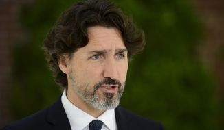 In this file photo, Prime Minister Justin Trudeau holds a press conference at Rideau Cottage during the COVID-19 pandemic in Ottawa on Friday, June 5, 2020. Mr. Trudeau was apparently the target of an armed man who crashed through a gate near the prime minister's residence on July 2, 2020.  (Sean Kilpatrick/The Canadian Press via AP)
