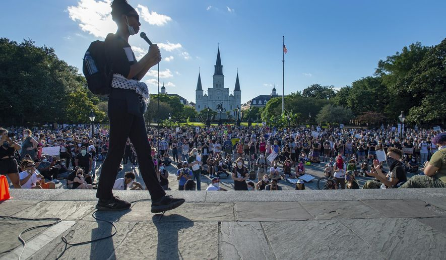 In this Friday, June 5, 2020, photo, protesters fill the streets around Jackson Square in the French Quarter in New Orleans, to demonstrate against the death of George Floyd who died after he was restrained by Minneapolis police on May 25 and broader issues of police brutality. (Scott Clause/The Daily Advertiser via AP)