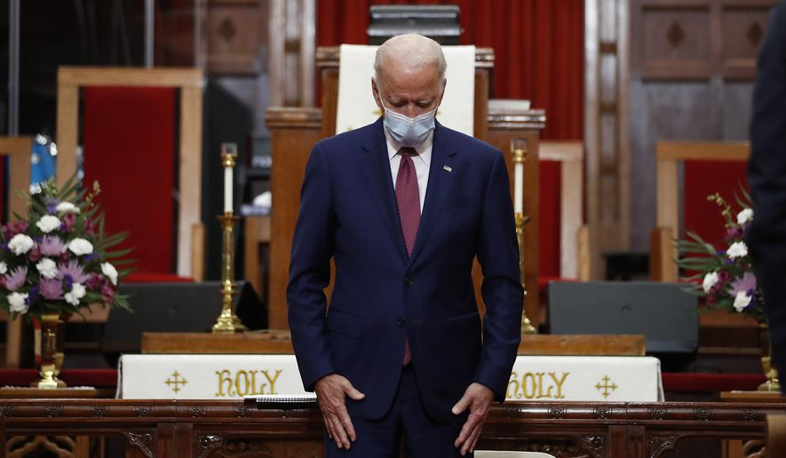 In this file photo, Democratic presidential candidate, former Vice President Joe Biden bows his head in prayer during a visit to Bethel AME Church in Wilmington, Del., Monday, June 1, 2020. (AP Photo/Andrew Harnik)