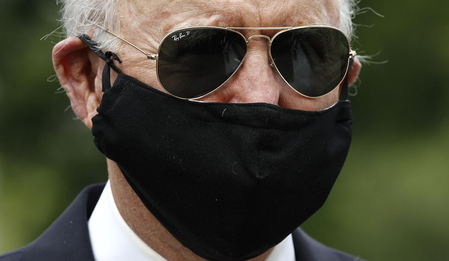FILE - In this May 25, 2020, file photo Democratic presidential candidate, former Vice President Joe Biden wears a face mask to protect against the spread of coronavirus as he and Jill Biden depart after placing a wreath at the Delaware Memorial Bridge Veterans Memorial Park in New Castle, Del. Biden has won the last few delegates he needed to clinch the Democratic nomination for president. (AP Photo/Patrick Semansky, File)