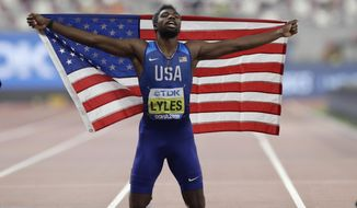 FILE - In this Oct. 1, 2019, file photo, Noah Lyles of the United States, celebrates winning the gold medal in the men's 200 meter final at the World Athletics Championships in Doha, Qatar. Lyles is spending his time these days trying to process what's happening in his country — a land riven with protests, pain and questions in the aftermath of the killing of George Floyd. (AP Photo/Petr David Josek, File)
