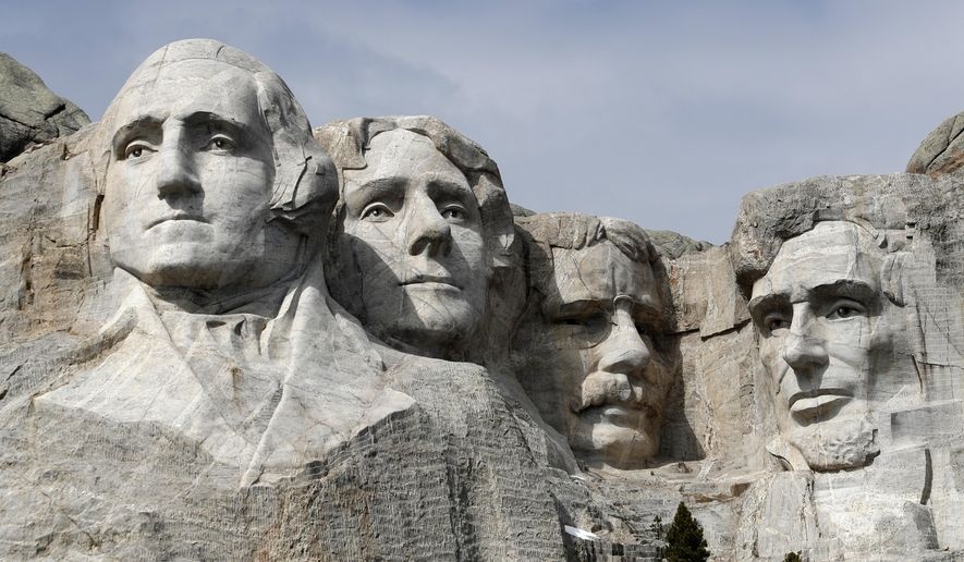 This March 22, 2019, file photo shows Mount Rushmore in Keystone, S.D. Organizers have scrapped plans to mandate social distancing during President Donald Trump's appearance at a July 3, 2020, Mount Rushmore fireworks display and won't limit the crowd due to coronavirus concerns, South Dakota Gov. Kristi Noem said Thursday, June 4, 2020. The Republican governor said the National Park Service is dolling out 7,500 tickets via lottery for the event, which marks the first time in a decade that fireworks will be set off at the memorial in recognition of Independence Day. (AP Photo/David Zalubowski, File)