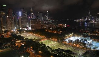 People gather for a vigil for the victims of the 1989 Tiananmen Square Massacre at Victoria Park in Causeway Bay, Hong Kong, Thursday, June 4, 2020, despite applications for it being officially denied. China is tightening controls over dissidents while pro-democracy activists in Hong Kong and elsewhere try to mark the 31st anniversary of the crushing of the pro-democracy movement in Beijing's Tiananmen Square. (AP Photo/Vincent Yu)