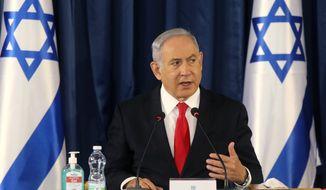 Israeli Prime Minister Benjamin Netanyahu chairs the weekly cabinet meeting in Jerusalem, Sunday, June 7, 2020. (Menahem Kahana/Pool Photo via AP)