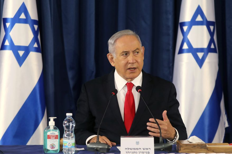 Israeli Prime Minister Benjamin Netanyahu chairs the weekly cabinet meeting in Jerusalem, Sunday, June 7, 2020. (Menahem Kahana/Pool Photo via AP)