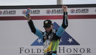 Kevin Harvick celebrates after winning a NASCAR Cup Series auto race at Atlanta Motor Speedway, Sunday, June 7, 2020, in Hampton, Ga. (AP Photo/Brynn Anderson)