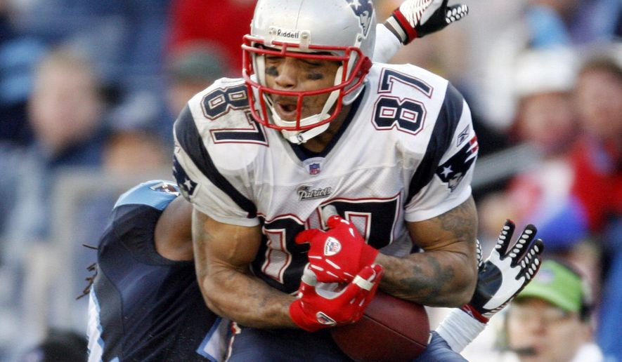 FILE - In this Dec. 31, 2006, file photo, New England Patriots wide receiver Reche Caldwell (87) catches a pass for a 62-yard touchdown ahead of Tennessee Titans cornerback Reynaldo Hill in the third quarter of an NFL football game in Nashville, Tenn. Caldwell, the former University of Florida and NFL receiver, was fatally shot Saturday, June 6, 2020, in his hometown. Caldwell's mother, Deborah, did not return phone messages left by The Associated Press on Sunday, but confirmed her son's death to the Tampa Bay Times. (AP Photo/John Russell, File)