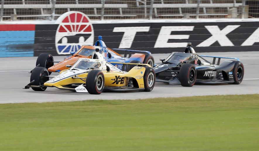 Josef Newgarden, front, Scott Dixon, rear, and Felix Rosenqvist, right, race down the front stretch during an IndyCar auto race at Texas Motor Speedway in Fort Worth, Texas, Saturday, June 6, 2020. (AP Photo/Tony Gutierrez)  **FILE**