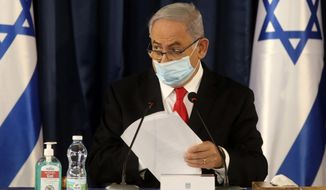 Israeli Prime Minister Benjamin Netanyahu, wearing a protective mask due to the COVID-19 pandemic, chairs the weekly cabinet meeting in Jerusalem, Sunday, June 7, 2020. (Menahem Kahana/Pool Photo via AP)