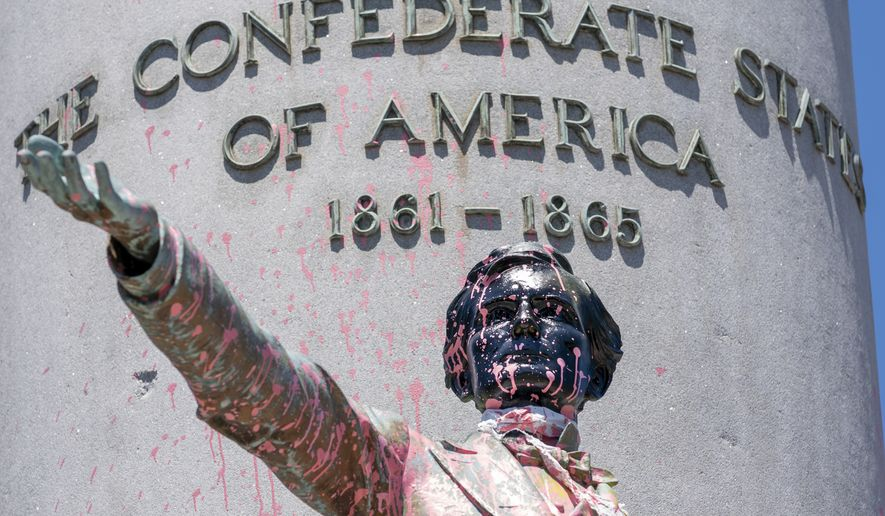 Paint and protest graffiti covers the Jefferson Davis Memorial in Richmond, Va., Sunday, June 7, 2020, following a week of unrest in the U.S. against police brutality and racism in policing. Jefferson Davis was the president of the Confederate States of America during the Civil War. (AP Photo/J. Scott Applewhite)