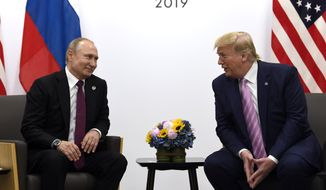 U.S. President Donald Trump and Russian President Vladimir Putin meet at the 2019 G-20 summit in this June 28, 2019 file photo.  (AP Photo/Susan Walsh, File) **FILE**