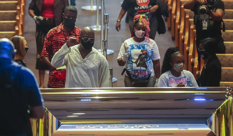 Mourners are guided into the Fountain of Praise Church during a public visitation for George Floyd Monday, June 8, 2020, in Houston. Floyd died after being restrained by Minneapolis Police officers on May 25. (Godofredo A. Vásquez, Houston Chronicle via AP, Pool)